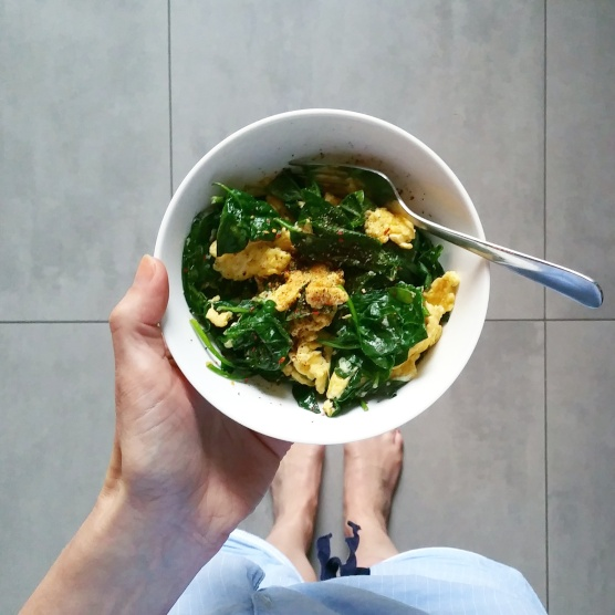 Scrambled eggs in coconut oil with baby spinach