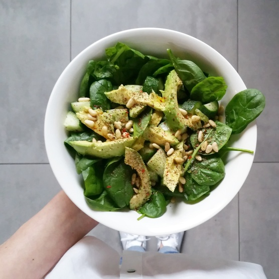 Salad with baby spinach, avocado, pine nuts, cucumber and avocado oil